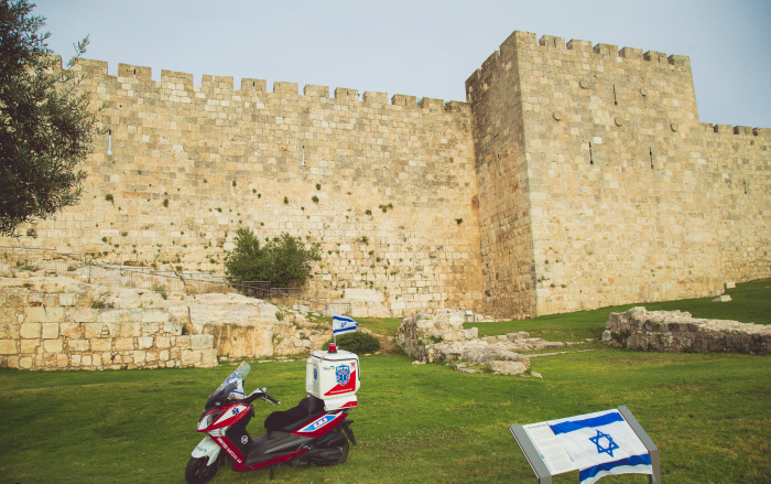 An ambucycle in front of the Old City walls in Jerusalem