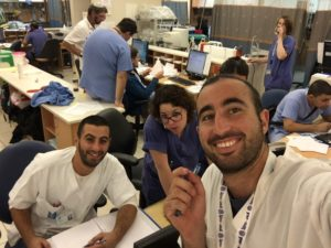 United Hatzalah volunteer medics Gavriel Struck and Shmuel Dahuki take a moment out of helping nurses in Jerusalem's Hadassah Ein Kerem hospital as part of the hospital liaison program.