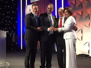 (From left to right) United Hatzalah EMT Gavy Friedson, and Founder and President of United Hatzalah Eli Beer, Present the Hatzalah Champions Award to Elie and Siona Alyeshmerni