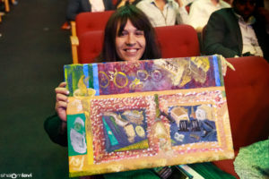 Gittel Beer receives the painting by Lipa Schmeltzer