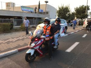 Education Minister Naftali Bennett assessed the situation in Haifa from the back of a United Ambucycle on Thursday