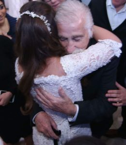 Sara Lee and her grandfather celebrating her wedding to Yoni  Credit: Courtesy of Barel and Toledano families