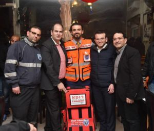 Dr. Murad Odeh (center) stands with the directors of  United Hatzalah