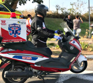 (Photo: Rachamim with his ambucycle responding to a call in Bat Yam. Credit: United Hatzalah)