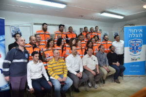 Eli Pollack, (bottom row center) attends graduation ceremony of EMT class in Tel Aviv before heading to the wedding.