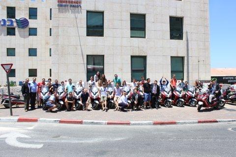 United Hatzalah staff pose in front of Jerusalem headquarters