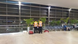 Moshe and Dvir treat the patient in the airport.