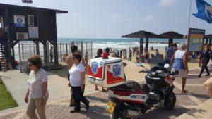 A responder patrols one of the beaches in Haifa