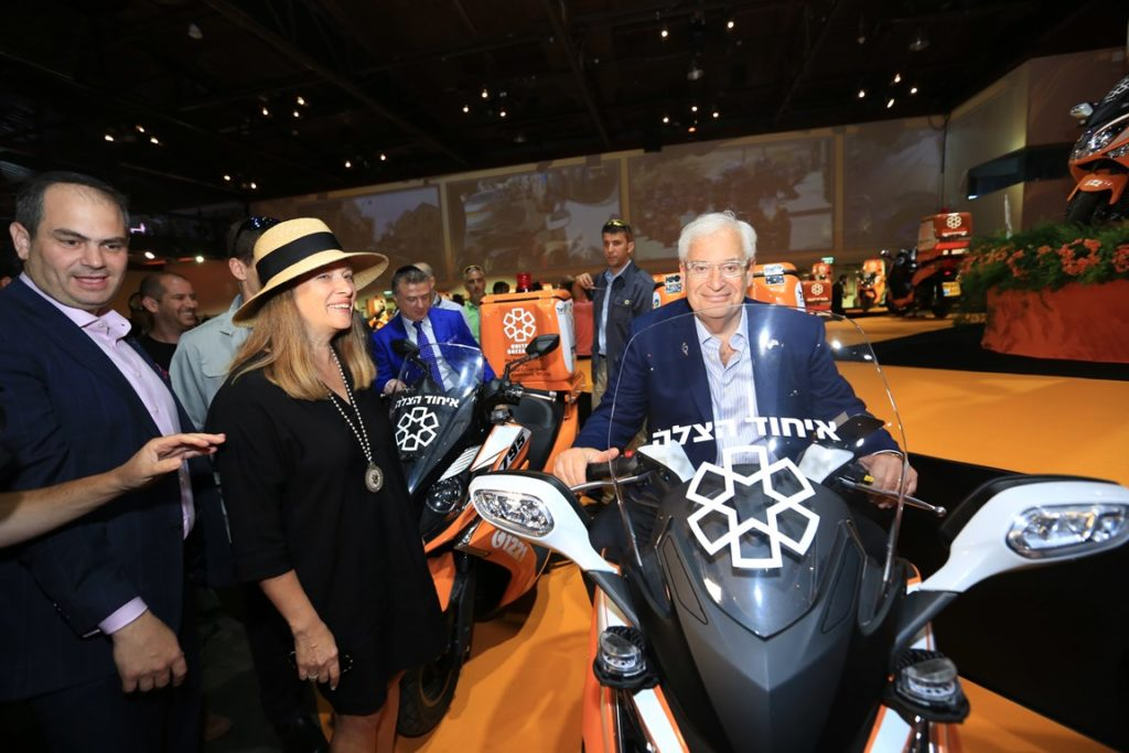 U.S. Ambassador David Friedman sits astride an ambucycle that was dedicated in his honor.