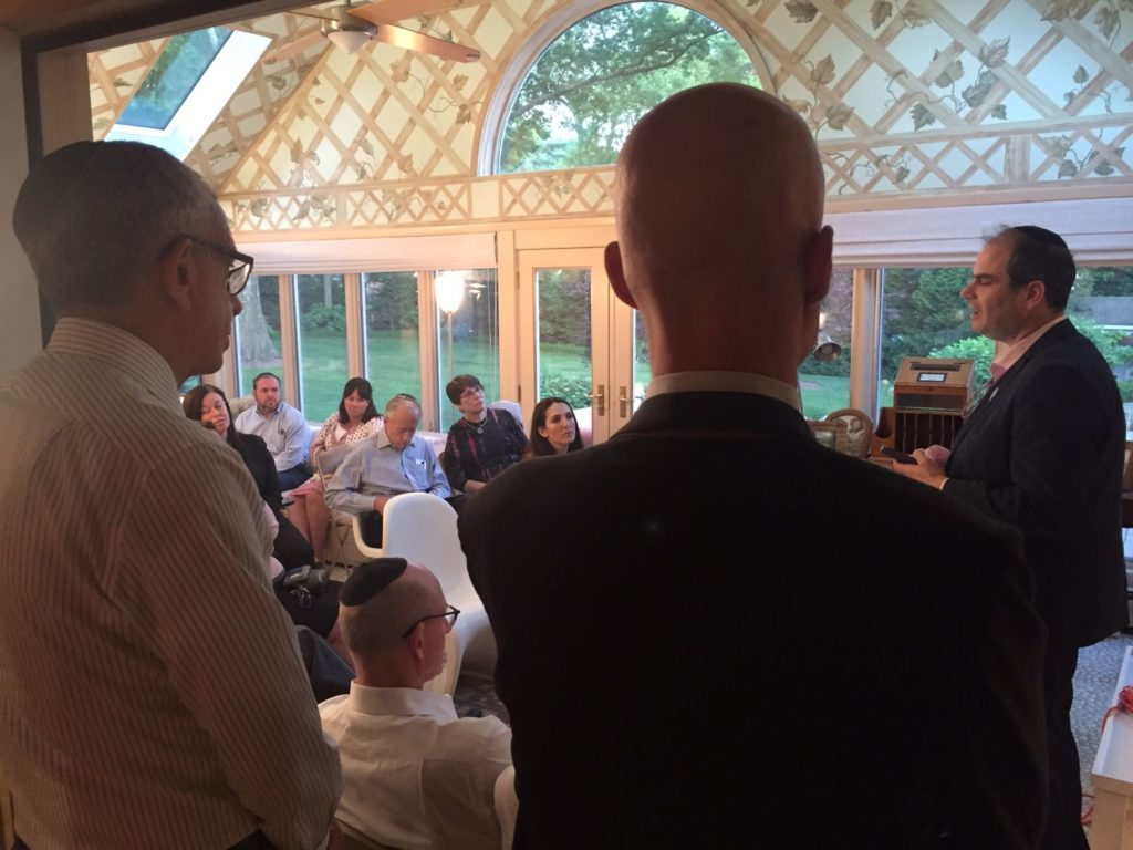 Jason Katz speaking at the parlor meeting at the Steinberger's house
