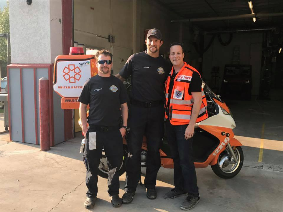 United Hatzalah EMT Gavy Friedson assists local EMS teams on call during lecture he was giving them.