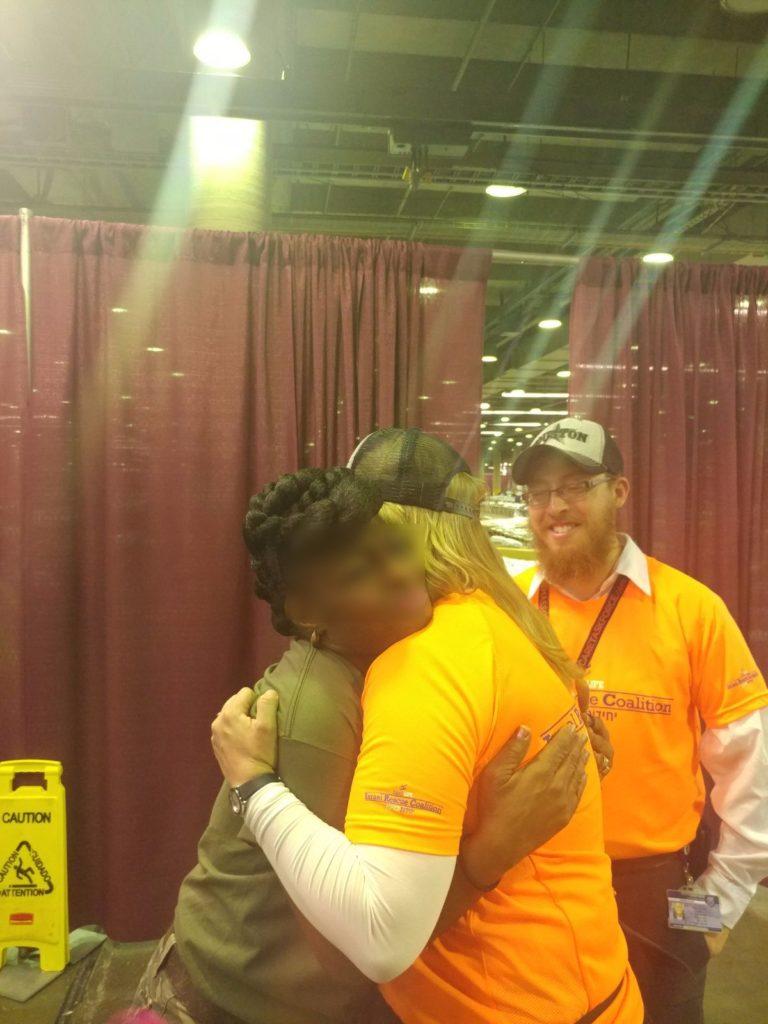 Team Leader Miriam Ballin receives a hug from an evacuee in Dallas.