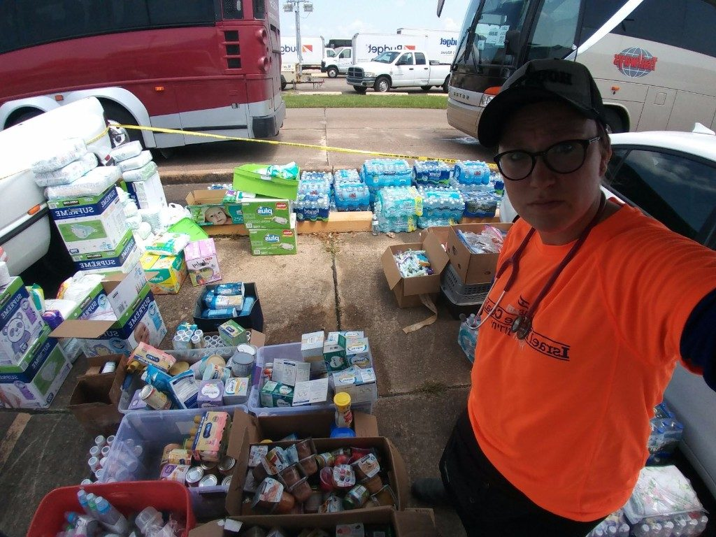 Team leader Miriam Ballin with aid items for evacuees at Jhn Brooks Regional Airport in Beaumont on Friday